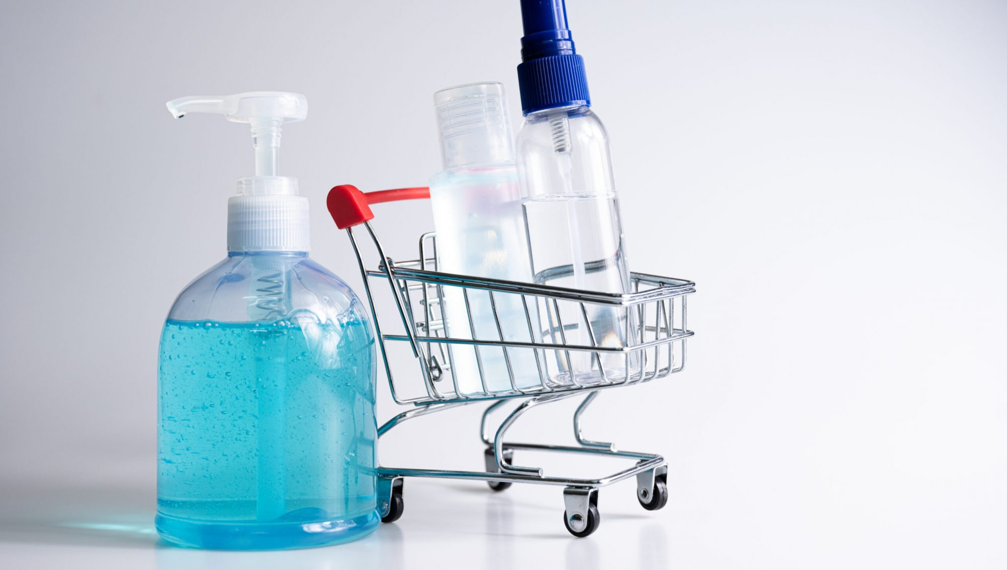 Alcohol spray, hand sanitizer gel for prevention germ and coronavirus vaccine in trolley, cart shopping online